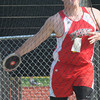 North reading: Amesbury's Mike McIntyre  throws the discus at the Div 4 championship at North Reading High. Jim Vaiknoras/staff photo