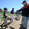 Beverly: Players shake hands with longtime coach Jack Dean at the Opening Day ceremonies for the Beverly Little League at Harry Ball Field Sunday morning. Jim Vaiknoras/Staff photo