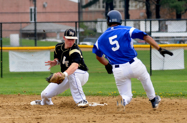 Peabody: Bishop Fenwich's Mike Davis gets ready to tag out Danvers' Mike Valles on a steal attempt during thier game at Fenwich Sunday. Jim Vaiknoras/staff photo