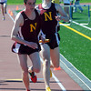 Peabody: Newburyport's John Stansel hand the batton to Andrew Orlando in the 4x1 mile race at the Mass. State Track Coaches Relays Sunday at Bishop Fenwick. Jim Vaiknoras/Staff photo