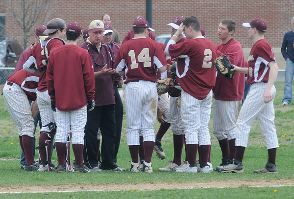 North Reading:Newburyport coach Bill Pettingill talks with his players during the Clippers loss to the Hornest Saturday at North Reading. JIm Vaiknoras/Staff photo