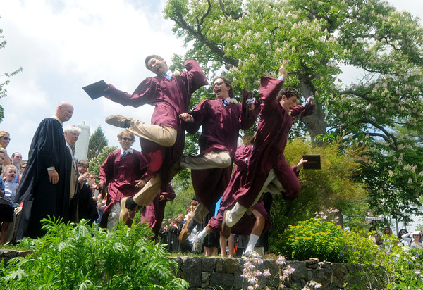 """Byfield: Graduates  """"Jump the wall"""" , a long tsanding tradition at the 248th of the Governor's Academy in Byfield Sunday. Jim Vaiknoras/Staff photo"""
