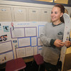 Amesbury: Eighth grader Madison MacLean explains how different types of wax effects skiing of different types of terrian during the openhouse at the Amesbury Middle School Thursday night. The event showcased educational projects done by the students.Jim Vaiknoras/Staff photo