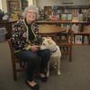 Newburyport: Judy Avery and her dog Zi Wi at teh Brown School library in Newburyport. Jim Vaiknoras/Staff photo