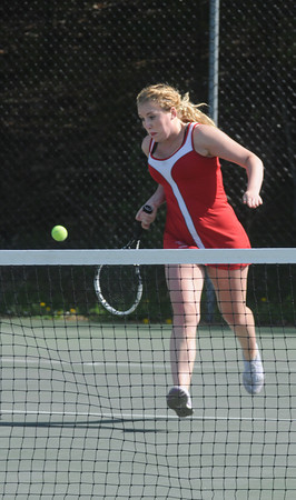 Amesbury: Amesbury singles player Stephanie Abraham returns a shot during her match at home against Triton. Jim Vaiknoras/Staff photo