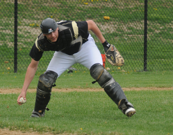 Peabody: Bishop Fenwich's Gianni Esposito field a bunt before throwing out a Danvers runner during their game at Fenwich Sunday. Jim Vaiknoras/staff photo