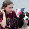 Newburyport: Lelsey Logan and her dog Rosie watch the Newburyport Memorial Day service Monday at City Hall. Jim Vaiknoras/Staff photo