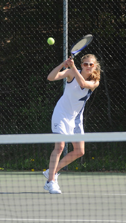Amesbury: Triton singles player Sidney White returns a shot at Amesbury Friday night. Jim Vaiknoras/Staff photo