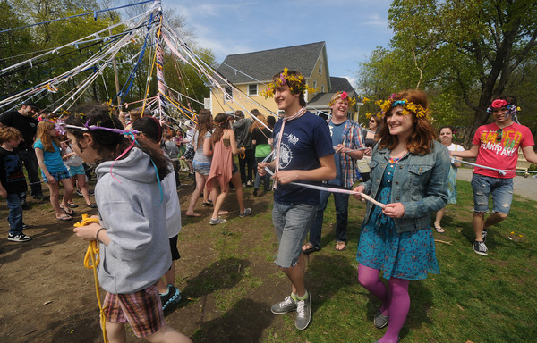 Amesbury: Students at the Sparhawk School in Amesbury celebrate spring at as the walk around the May Pole at their May Day celebration Friday . JIm Vaiknoras/Staff photo
