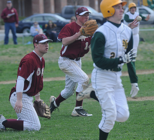 North Reading:Newburyport's Ryan O'Connor throws out a North Reading runner on a butt while Jimmy Conway looks on during the Clippers loss to the Hornest Saturday at North Reading. JIm Vaiknoras/Staff photo