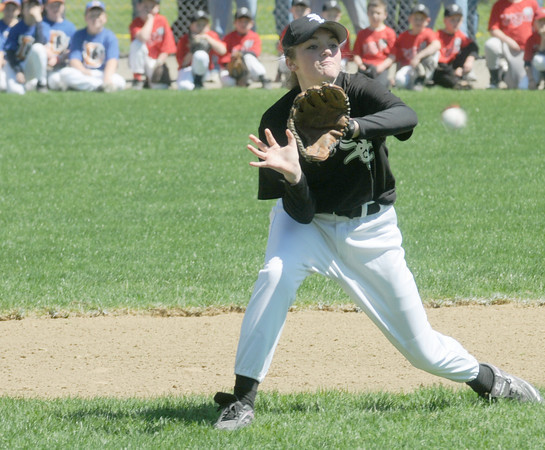 Beverly:White Sox major leaguer Kaitlyn Munzing makes a play on the ball during an infield drill at the Opening Day ceremonies for the Beverly Little League at Harry Ball Field Sunday morning. Jim Vaiknoras/Staff photo