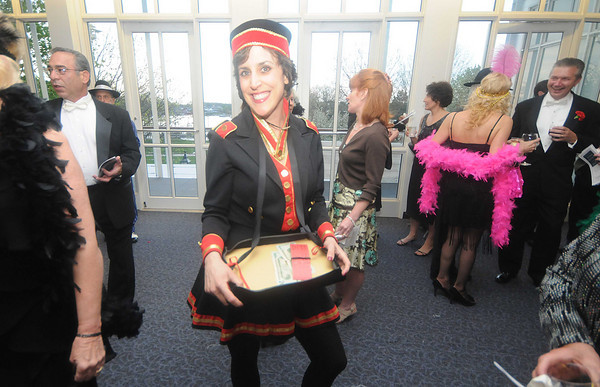 Newburyport: Melissa Moore sell raffle tickets dressed as a cigarette girl at the Roaring 20's , 20th anniversary celebration fundraiser at the Fireghouse in Newburyport Saturday night. JIm Vaiknoras/Staff photo<br /> party at the Firehouse