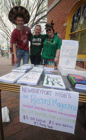 """Newburyport: Newburyport high students Jack Hanke,Gretchen Cyros , and Hannah Zwickerhill run a peotry booth at the Newburyport Literary Featival Saturday. For a donation to the Pettengill House they would write you a poem, they were also selling copies of Newburyport high's """"The Record Magizine"""". Jim Vaiknoras/Staff photo"""