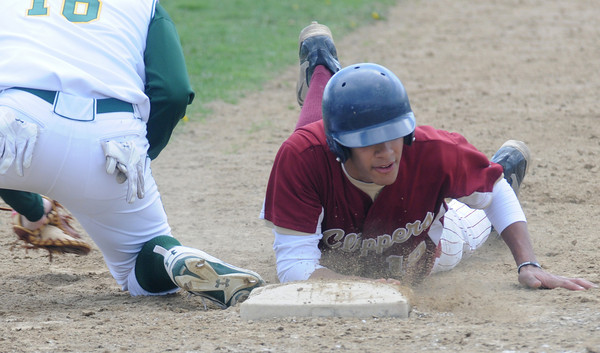 North Reading:Newburyport's Drew Carter dives safely back to first during the Clippers loss to the Hornest Saturday at North Reading. JIm Vaiknoras/Staff photo