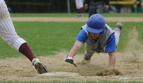 Georgetown:Georgetown's Jared Lathrop kicks up soime dirt as he dives safely back to first during the Royals game aqainst Newburyport at Georgetown Saturday. Jim Vaiknoras/Staff photo