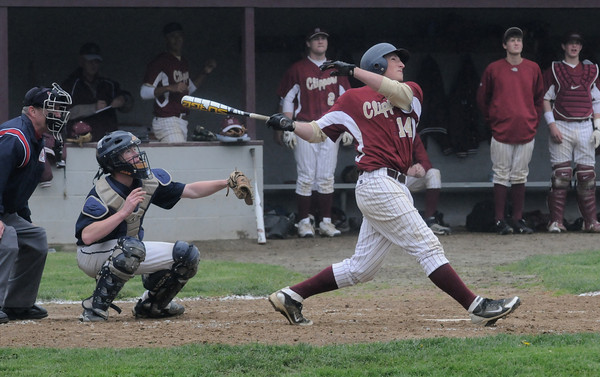 Newburyport: Newburyport's Ryan O'Connor hits a 3 run homer against Wilmington at the Lower Field in Newburyport. Jim Vaiknoras/Staff photo
