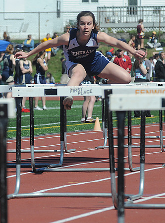 Peabody: Hamilton-Wenham's Tyler Parady in teh 4x100m hurtles at the Mass. State Track Coaches Relays Sunday at Bishop Fenwick. Jim Vaiknoras/Staff photo