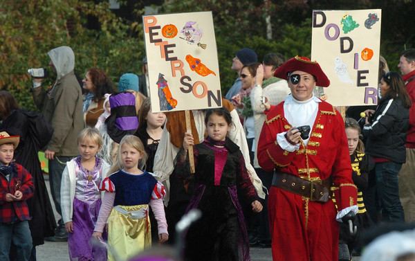 """Amesbury: Students at the Cashman School in Amesbury head out on their annual Halloween Parade yesterday morning to the music blaring """"Monster Mash."""" The event was delayed a day due to the weekend storm which kept the school closed on Monday. Bryan Eaton/Staff Photo"""