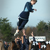 Byfield: The Triton football cheerleaders perform some acrobatics during yesterdays Thanksgiving Day game against Pentucket. Bryan Eaton/Staff Photo