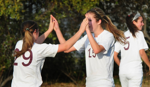 Newburyport: Newburyport players Liza Twomey, left, and Hannah Martin give the high fives after Newburyport scored their first goal of the game. Bryan Eaton/Staff Photo