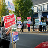 Amesbury: Sign-holders were out in force in Amesbury yesterday afternoon supporting the various candidates. Bryan Eaton/Staff Photo