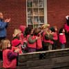 Newburyport: Montessori students applaud as this year's Newburyport Christmas tree is lowered into place late Thursday morning. Bryan Eaton/Staff Photo
