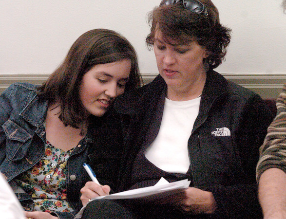 Newburyport: Micaela McCarthy, 16, leans on her mother Audrey shortly before learning she won a spot on the Newburyport School Committee. Bryan Eaton/Staff Photo