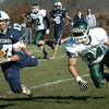 Byfield: Triton's Dominic Rovetto catches the pass as Pentucket's Cody Rothwell gives coverage. Bryan Eaton/Staff Photo