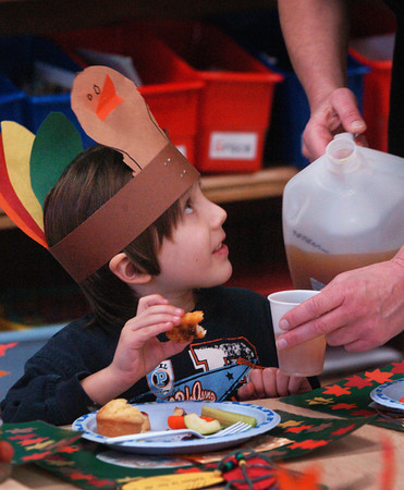 Newburyport: Vincent Montoya, 5, gets another class of apple cider at the Brown School in Newburyport on Tuesday afternoon. He was in Melissa Duguie's class where children were celebrating their Harvest Feast. Bryan Eaton/Staff Photo