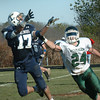 Byfield: Triton's Dominic Rovetto catches this pass as Pentucket's Cody Rothwell gives coverage. Bryan Eaton/Staff Photo