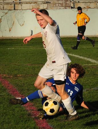 Newburyport: Newburyport's Adam Traxler moves the ball past a fallen Methuen player yesterday afternoon. Bryan Eaton/Staff Photo