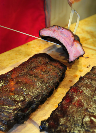 Newburyport: Larkin slices up his pork ribs. Bryan Eaton/Staff Photo