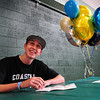 West Newbury: Pentucket's Alex Ministeri smile to those in attendance as his signs a letter of intent to play baseball at Coastal Carolina next year.  Bryan Eaton/Staff Photo