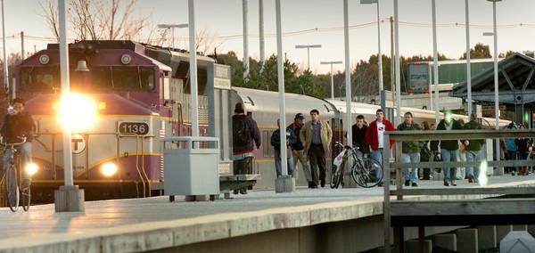 Newburyport: Riders get off the MBTA commuter train at the Newburyport Station yesterday afternoon. Bryan Eaton/Staff Photo