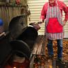 Newburyport: Backyard smoker Fran Larkin takes ribs out. Bryan Eaton/Staff Photo