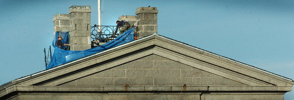 Newburyport: Workers have been atop the Custom House Maritime Museum in downtown Newburyport lately. The building, built in 1835, is getting parts of the roof repaired and some painting done as well. Bryan Eaton/Staff Photo