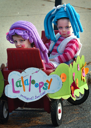 Amesbury: Twins Lauren Talbot, 2, left, and Ellis watch the Halloween Parade at the Cashman School on Tuesday morning. They were looking for their sister Hayden, who is first grade at the Amesbury School. Bryan Eaton/Staff Photo