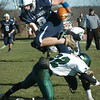 Byfield: Triton's Ryan Clark flies over Pentucket defender Jeff Porter yesterday in Byfield. Bryan Eaton/Staff Photo