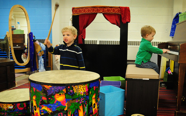 Newbury: James Armstrong, left, and Logan MacKnight, both 2, check out the instruments during an open house at the Our Secret Garden Preschool at the First Parish Church in Newbury. Bryan Eaton/Staff Phot0
