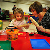 Newbury: Haley Penney, 3, rolls Play-Dough with Ellie Dawson, director of the new Our Secret Garden Preschool at the First Parish Church in Newbury. Bryan Eaton/Staff Photo