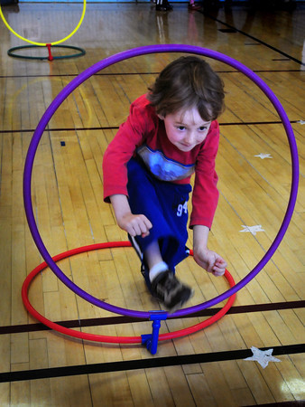 Newburyport: Beckett Sava, 6, runs through hoops Wednesday morning at the Brown School in Newburyport. He and his classmates were in Ali Pappas' gym class testing their skills on an obstacle course. Bryan Eaton/Staff Photo