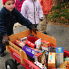 Newburyport: Brown School students, from left, Brent Barry, Delaney Guillou and Dalton Cronin head to the Salvation Army headquarters in Newburyport yesterday morning with non-perishable food.  Students in Dianna Ouellette's class collected food to fill three of these wagons to donate to the agency's food pantry, which they do every year for Thanksgiving. Bryan Eaton/Staff Photo