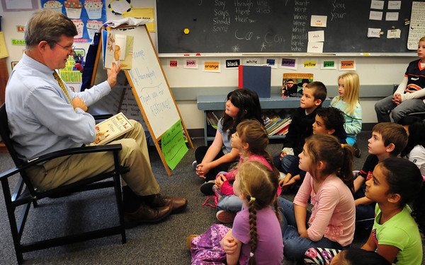 "Salisbury: Salisbury town manager Neil Harrington reads ""If You Gave a Pig a Pancake"" to Betthany Marshall's class at Salisbury Elementary School on Wednesday. He was reading for the school's observance of National Family Literacy Month. Bryan Eaton/Staff Photo"