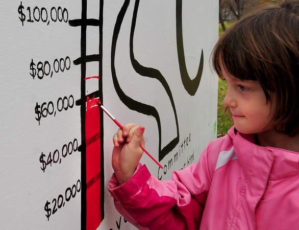Amesbury: Hannah Nahas, 5, paints in $15,000 on the graph for the fundraising to improve the playground at Amesbury Town Park. Bryan Eaton/Staff Photo