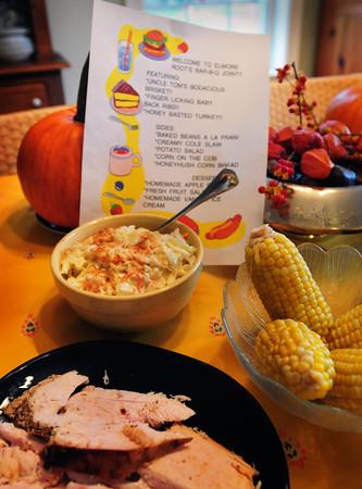 "Newburyport: The menu at ""Elmore Root's Bar-B-Q-Joint"" include cole slaw, corn on the cob and Honey Basted Turkey. Bryan Eaton/Staff Photo"