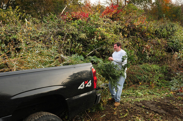 Amesbury: Amesbury homeowner Joel Hooker removes branches knocked down from the weekend storm at the town compost site as the area continues to clean up the debris. Bryan Eaton/Staff Photo
