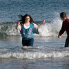 Salisbury: Siblings Rebecca Perry, 12, left, and James, 13, of Nashville, Tennessee jumped into the Atlantic Ocean at Salisbury Beach yesterday afternoon. The two were up for a family wedding, and their mother, Sheila, who's from Methuen originally, took them to the beach where she used to visit growing up. Bryan Eaton/Staff Photo