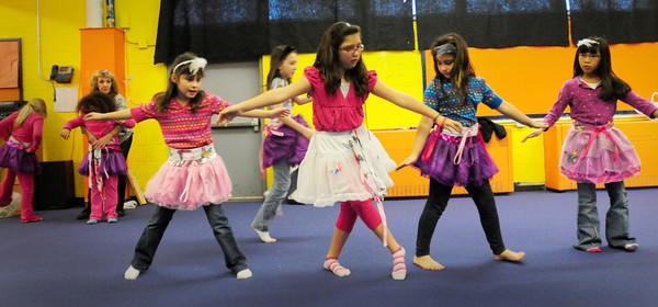 Salisbury: Girls at the Boys and Girls Club practice their ballet steps for Friday's recital at the Salisbury facility. Bryan Eaton/Staff Photo