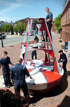 Newburyport: <br /> Coast Guard crew scraped and painted the two buoys outside the Custom House Maritime Museum the past two days. Several from Station Merrimack and the Aid To Navigation Team, which is responsible for buoys along the coast and inland waters, volunteered their time for the project.<br /> Bryan Eaton/File Photo