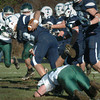 Byfield: Triton quarterback Blaise Whitman makes a carry against Pentucket yesterday in Byfield. Bryan Eaton/Staff Photo